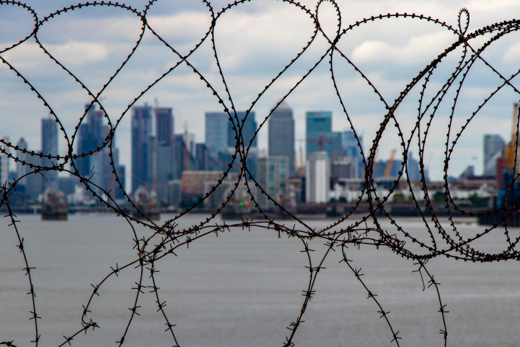 A view of the Docklands through barbed wire