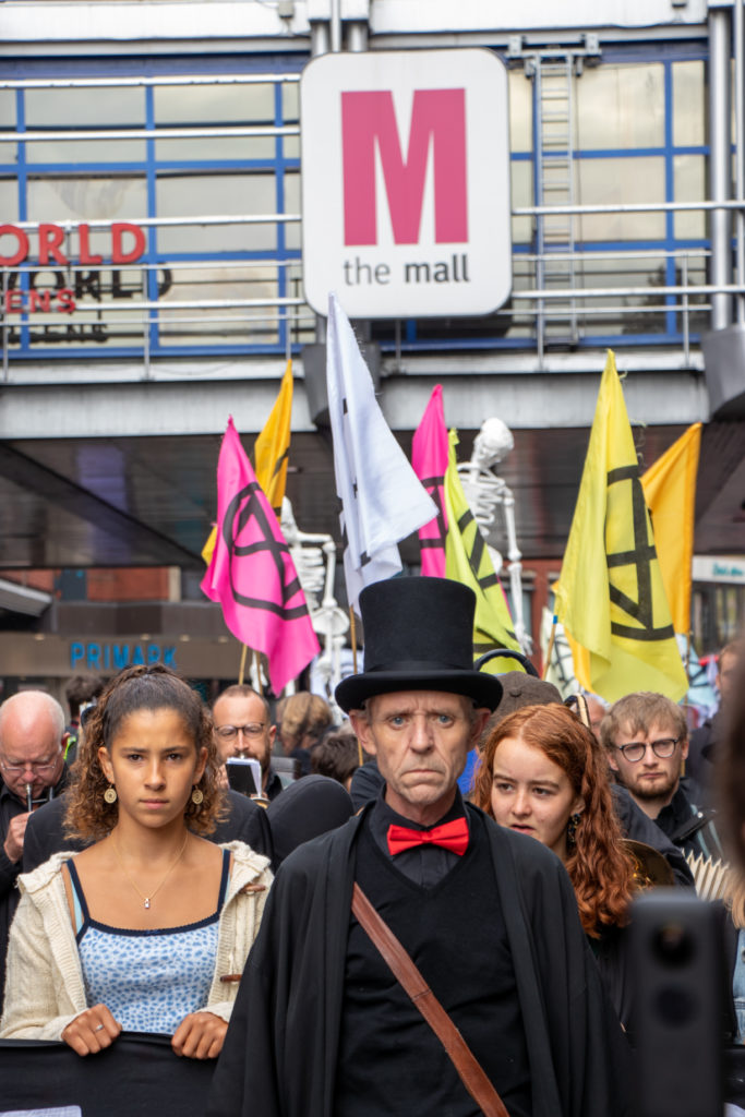 An image of the Extinction Reblellion funeral march passing through Wood Green as part fo the North London Uprising 2019