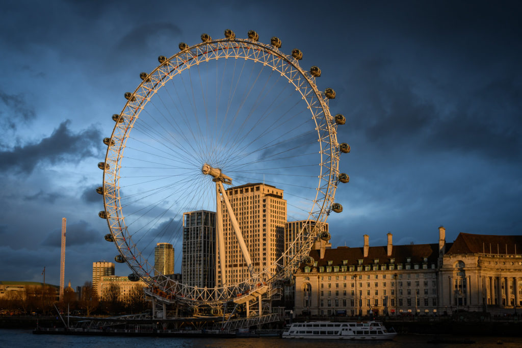 An image of the London Eye lit by the sun
